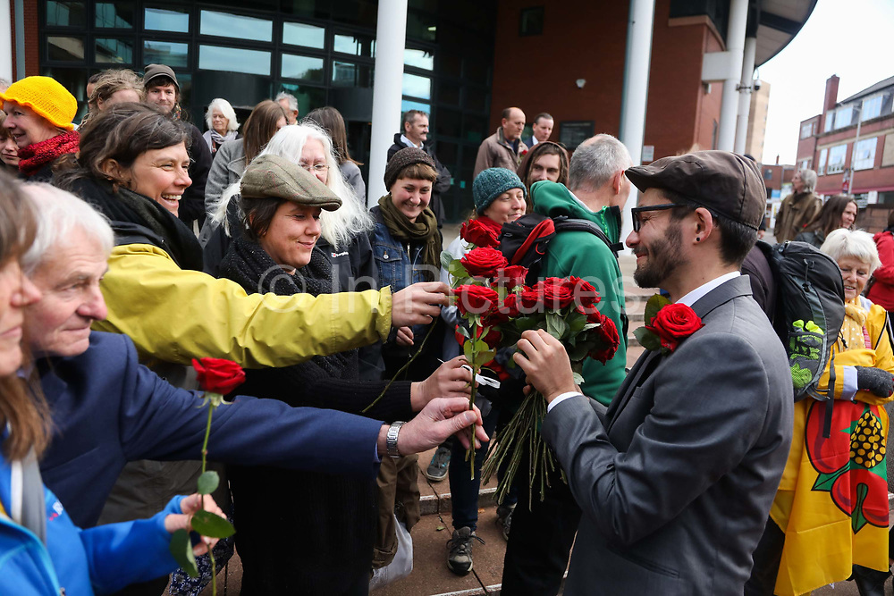 "Simon Roscoe Blevins receives red roses from his supporters as a show of solidarity,  September 25th, Preston, Lancashire, United Kingdom. Simon Roscoe Blevins, 26,  Richard Roberts, 36 were both sentenced 16 months in prison, Richard Loizou, 31, sentenced 15 months in prison and  and Julian Brock, 47 12 months supended. Simon Roscoe Blevins, 26,  Richard Loizou, 31, Richard Roberts, 36 and Julian Brock, 47 climbed on top of several trucks during a mass protest by locals and supporters in New Preston Road, against fracking in Lancashire, July 2017. The trucks were prevented form delivering equipment to Cuadrillas nearby fracking site for four days. After a seven day jury trial at Preston Crown Court in August 2018, the four men were found guilty of Public Nuisance. Judge Altham has told them to expect ""immediate custodial sentences"" on 25th September 2018."
