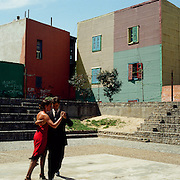 A panoramic view of tango dancing in front of colorful houses in La Boca district of Buenos AIres, Argentina. 23rd July 2011. Photo Tim Clayton