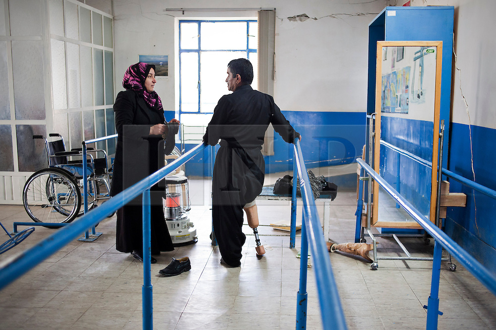 © Licensed to London News Pictures. 03/04/2013. London, UK. UN International Mine Awareness Day [FILE PHOTO NOT FOR ONLINE USE]. 51 year old Shawkat Qarkarab, a former shepherd, talks about his prosthetic leg to a technician at Halabja centre of the Kurdish Organisation for the Rehabilitation of the Disabled (KORD), Iraq. Photo credit: Matt Cetti-Roberts/LNP