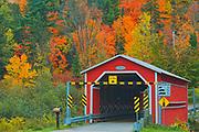 Covered bridge (pont couvert)  de Saint-Mathieu over the Shawinigan River. Autumn  colors. Great Lakes - St.  Lawrence Forest Region.<br />Saint-Mathieu-du-Parc<br />Quebec<br />Canada