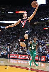 November 22, 2017 - Miami, FL, USA - The Miami Heat's Goran Dragic (7) on a layup in the fourth quarter against the Boston Celtics at the AmericanAirlines Arena in Miami on Wednesday, Nov. 22, 2017. The Heat won, 104-98. (Credit Image: © Al Diaz/TNS via ZUMA Wire)