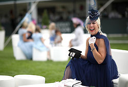 A female racegoer during ladies day of the 2018 Investec Derby Festival at Epsom Downs Racecourse, Epsom.