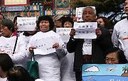BEIJING, CHINA - MARCH 08: (CHINA OUT) <br /> <br /> First Anniversary Of The Missing Malaysia Airline MH370 In Beijing<br /> <br /> The family members of victims prey at Yonghe Lama Temple during the first anniversary of the missing Malaysia Airline MH370 on March 8, 2015 in Beijing, China. Malaysia Airlines Flight MH370 from Kuala Lumpur to Beijing and carrying 239 onboard was reported missing on March 8, 2014.<br /> ©Exclusivepx Media