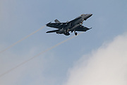A McDonnell Douglas F/A-18 Hornet with the American Navy in flies low over Chou Rinkan in Kanagawa, Japan. Tuesday May 31st 2016. People in this area live under the flight path of Naval Air facility, Atsugi airbase and have to get used to fighter jets and other aircraft of the US Navy and JSDF buzzing their apartment buildings.