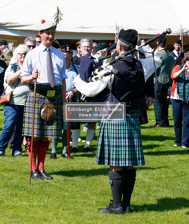 Inveraray Highland Games. Inveraray and District Pipe Band lead the parade from the town centre to the games field at Inveraray Castle. The Duke of Argyll and other dignitaries follow the pipe band to the games field where His Grace officially open the games..His Grace takes the salute before opening the games.... (c) Stephen Lawson   Edinburgh Elite media