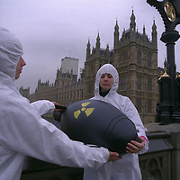 Symbolic 'return to sender' of 50 replica British nuclear bombs from RAF Bruggen in Germany to the Atomic Weapons Establishment at  Aldermaston, UK.  A human chain of 300 Greenpeace activists transported the bombs across Westminster Bridge to Parliament Square,  London, for transportation to Aldermaston.