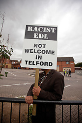 © Licensed to London News Pictures. 13/08/2011. Telford, UK. An anti-EDL protester. The EDL demonstrate against a paedophile ring in the small Telford town of Wellington. The group were going to march, however the Home Secretary imposed a ban on all marches in the area. About 300 EDL supporters attended. The EDL demonstration was counter-protested by about 300 people. Photo credit : Joel Goodman/LNP