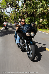 Hawaiian Bob Hattori riding his bagger through Tomoka State Park during Daytona Bike Week. FL. USA. Sunday March 18, 2018. Photography ©2018 Michael Lichter.