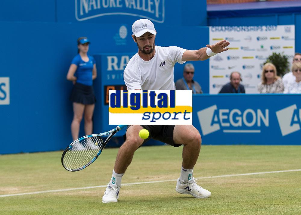 Tennis - 2017 Aegon Championships [Queen's Club Championship] - Day Four, Thursday <br /> <br /> Men's Singles: Round of 16 - Jordan THOMPSON (AUS) vs Sam QUERREY (USA)<br /> <br /> Jordan Thompson (AUS) gets down low to return at Queens Club<br /> <br /> COLORSPORT/DANIEL BEARHAM
