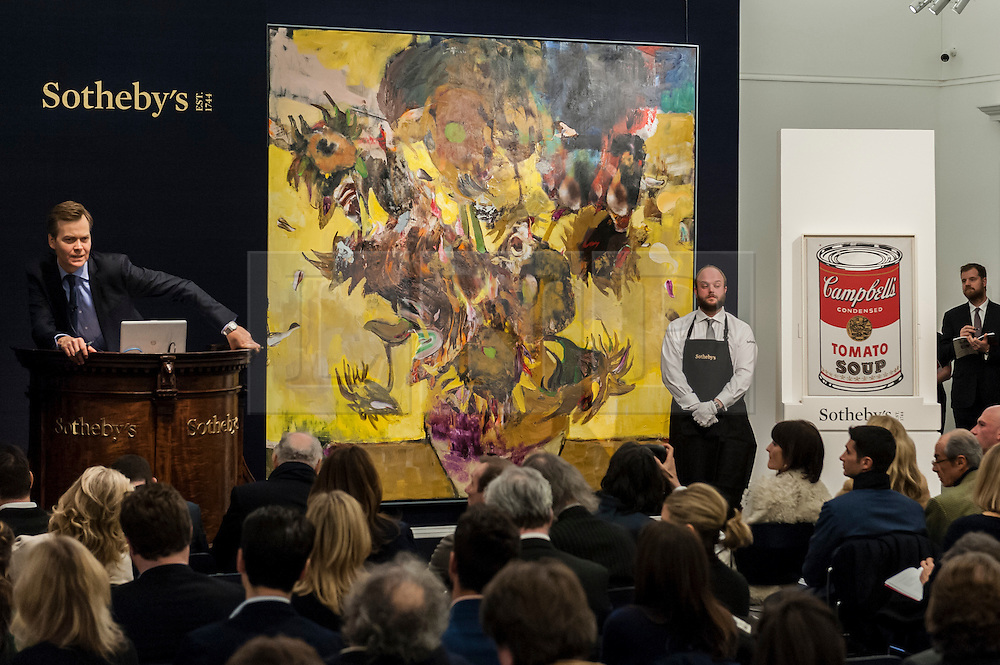 """© Licensed to London News Pictures. 10/02/2016. London, UK.  (L to R) Adrian Ghenie's """"The Sunflowers"""" and Andy Warhol's """"Large Campbell's Soup Can"""", which sold for a hammer price of £14.2m and £4.45m respectively, at Sotheby's Contemporary Art evening sale in New Bond Street.   Photo credit : Stephen Chung/LNP"""