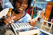 A vendor calculates the price of a sale at the 22nd Salon International de l'Artisanat de Ouagadougou (SIAO) in Ouagadougou, Burkina Faso on Saturday November 1, 2008.
