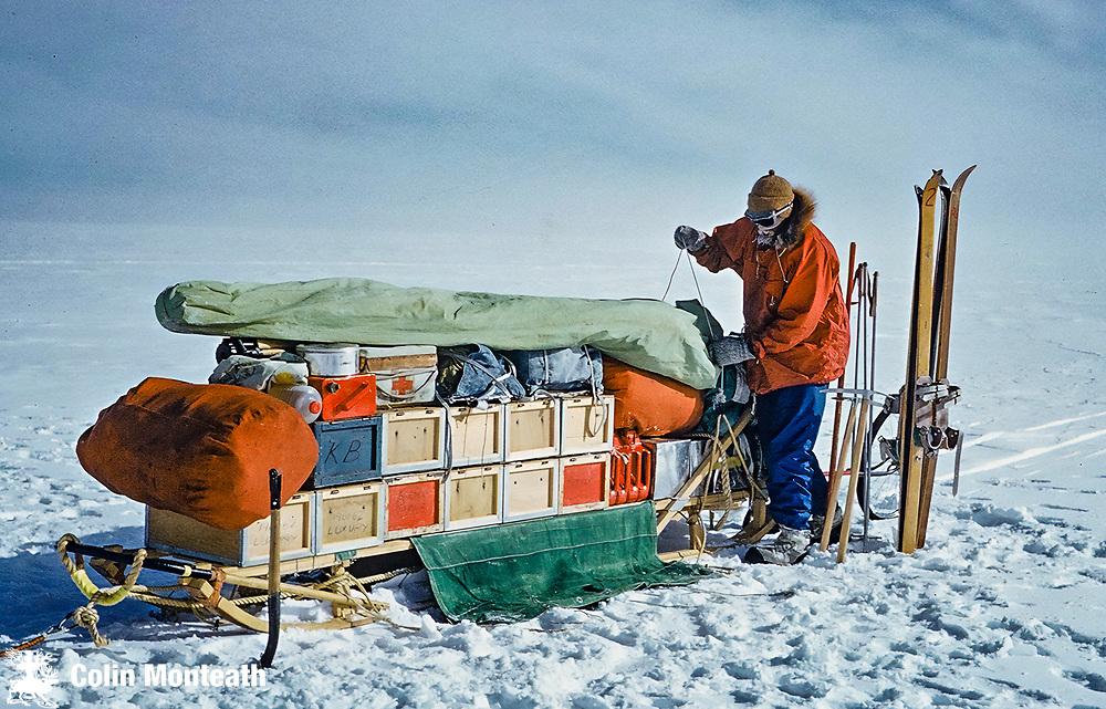 Loading food boxes and polar tent onto NZARP Nansen sledge, Nov 1961,