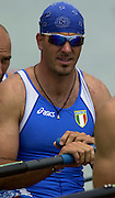 2003 - FISA World Cup Rowing Milan Italy.30/05/2003  - Photo Peter Spurrier.ITA M4X - ?Azzure pirate?, Rossano Galtarossa  prepares on the staring line with his crew matesin the italian men?s Quadruple scull, at the opening round of the 2003 FISA World Cup on the Idroscala rowing course in Milan Italy..Agostino Abbagnale, Simone Raineri,  Rossano Galtarossa and Alessio Sartori Equipment [Mandatory Credit: Peter Spurrier:Intersport Images]