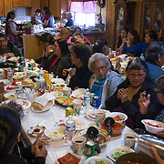 Once the gifts were brought in, everyone gathered at the tables set up in the dining and living room to have a feast.