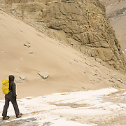 Renee trekking along the slope of Bonney Riegel at the Narrows that seperates the east and west lobes of Lake Bonney