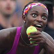 Sloane Stephens, USA, reacts was she hits signed balls into the crowd after her third set tie break victory over Mandy Minella, Luxembourg, during the Women's Singles at the US Open. Flushing. New York, USA. 25th August 2013. Photo Tim Clayton