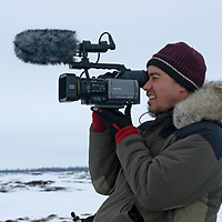 Videographer Andrew Okpeaha MacLean films  on the vast frozen tundra north of the Arctic Circle, near Nizhnyaya Pesha, Russia.