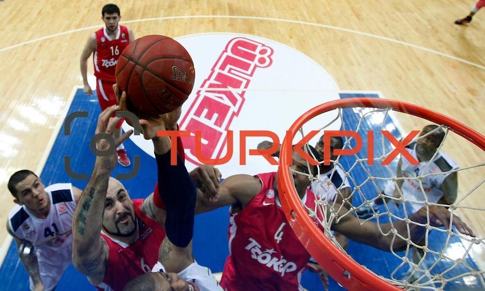 Olympiacos's Kyle Hines (C), Pero Antic (2ndL) during their Euroleague Basketball Top 16 Game 13 match Fenerbahce Ulker between Olympiacos at Fenerbahce Ulker Sports Aren in Istanbul, Turkey, Thursday, March 29, 2013. Photo by TURKPIX