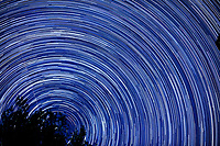 Star trails looking north from my backyard. Autumn night sky in New Jersey. Composite of 250 images taken with a Nikon D3x camera and 58 mm f/1.4 lens (ISO 100, 58 mm, f/2, 30 sec).