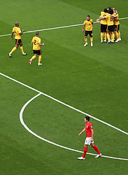 England's Harry Maguire (bottom) looks on as Belgium celebrate their side's first goal of the game during the FIFA World Cup third place play-off match at Saint Petersburg Stadium.