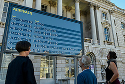© Licensed to London News Pictures. 10/09/2020. LONDON, UK.  Staff members view Arrivals + Departures, a major interactive installation in the courtyard of Somerset House by Yara and Davina.  The artwork allows the public to memorialise their names on the mechanical flipboards which are often seen at a railway station or airport and is on show until 10 October 2020.  Photo credit: Stephen Chung/LNP