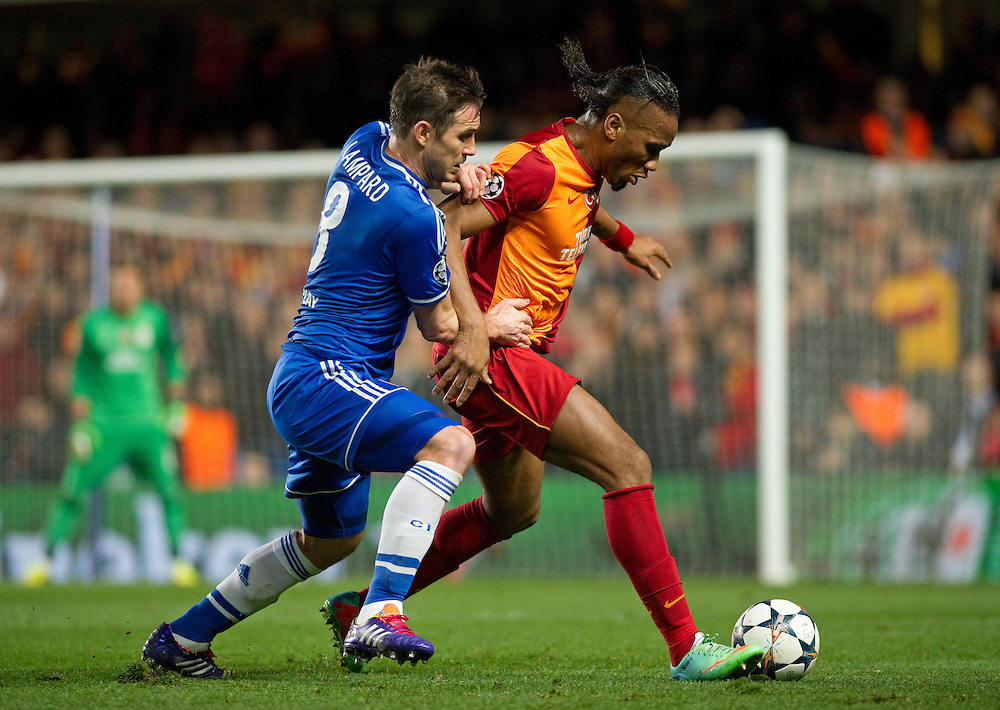 Galatasaray's Didier Drogba shields the ball from Chelsea's Frank Lampard<br /> <br /> Photo by Ashley Western/CameraSport<br /> <br /> Football - UEFA Champions League First Knockout Round 2nd Leg - Chelsea v Galatasaray - Tuesday 18th March 2014 - Stamford Bridge - London<br />  <br /> © CameraSport - 43 Linden Ave. Countesthorpe. Leicester. England. LE8 5PG - Tel: +44 (0) 116 277 4147 - admin@camerasport.com - www.camerasport.com