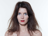 studio portrait of a beautiful woman on isolated on white background hair mess