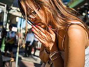 19 AUGUST 2015 - BANGKOK, THAILAND: A woman prays during the reopening of the Erawan Shrine. Erawan Shrine in Bangkok reopened Wednesday morning after more than 20 people were killed and more than 100 injured in a bombing at the shrine Monday, August 17, 2015. The shrine is a popular tourist attraction in the center of Bangkok's high end shopping district and is an important religious site for Thais. No one has claimed responsibility for the bombing.      PHOTO BY JACK KURTZ