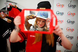 "© Licensed to London News Pictures. 17/09/2016. London, UK. Franziska Pullmann tries a ""Ginge"" hat on as hundreds of redheads attend Redhead Day UK event in Angel, London on Saturday, 17 September 2016. Natural redhead visitors get chance to celebrate their ginger genes and shop specialised products, see ginger related exhibitions and live performances. Photo credit: Tolga Akmen/LNP"