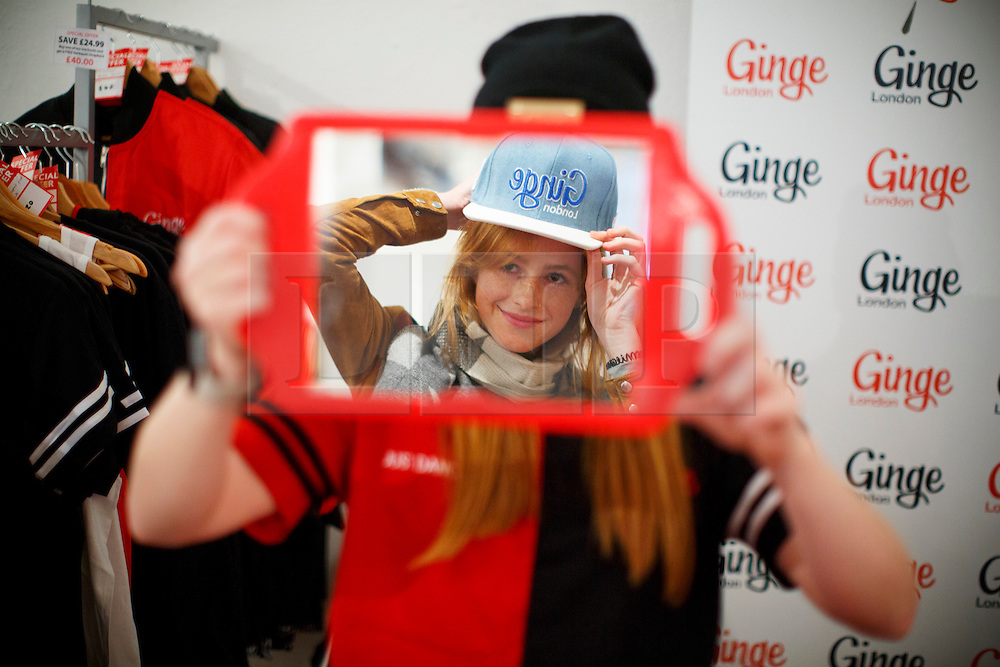 """© Licensed to London News Pictures. 17/09/2016. London, UK. Franziska Pullmann tries a """"Ginge"""" hat on as hundreds of redheads attend Redhead Day UK event in Angel, London on Saturday, 17 September 2016. Natural redhead visitors get chance to celebrate their ginger genes and shop specialised products, see ginger related exhibitions and live performances. Photo credit: Tolga Akmen/LNP"""