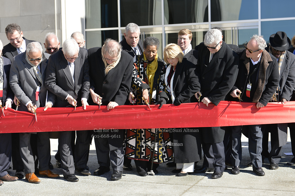 """Photo ©Suzi Altman 12/9/17 Jackson,MS Front and center for the ribbon cutting at the new Civil Rights and History Museums in Mississippi is Myrlie Evers- Williams, widow of slain civil rights leader Medgar Evers. President Trump made private remarks during the grand opening of the Civil Rights and History Museums in Jackson Mississippi inside to a private crowd, before ribbon cutting.  Pictured at ribbon cutting ceremony, center,  Myrlie Evers, to her right Mrs. Bryant and MS. Governor Phil Bryant. Trump spoke to a small private group of civil rights icons, museums directors, and other elected officials including MS. Governor Bryant in the auditorium after his brief tour of the museum. Trump said """"the Civil Rights Museum is a tribute to our nation and to the State of Mississippi """" and he paid tribute to other leaders of the civil rights movement including James Meredith and Medgar Evers . Trumps appearance was controversial to many residents of the state of Mississippi and protests were scattered around the museums exterior.   Myrlie Evers- William widow of slain civil rights icon Medgar Evers attended the opening of the Mississippi Civiil Rights and History Museums. Evers spoke to the crowd outside after President Trump made private remarks inside to a closed audience of invited guests and press only. <br />  Right before the ribbon cutting ceremony outside on the podium Mrs Evers said """" These museums are priceless, going through the museum of my history I felt the bullets and the fears, but I also felt the hope."""" President Trump had a very short private tour of the Civil Rights Museum and did not mingle outside or stop to talk with any visitors to the new Civil Rights  museum. Photo©SuziAltman"""