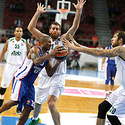 Anadolu Efes's Dontaye Draper (L) and Unics Kazan's Dmitry Sokolov (R) during their Turkish Airlines Euroleague Basketball Group A Round 1 match Anadolu Efes between Unics Kazan at Abdi ipekci arena in Istanbul, Turkey, Thursday, October 16, 2014. Photo by Aykut AKICI/TURKPIX