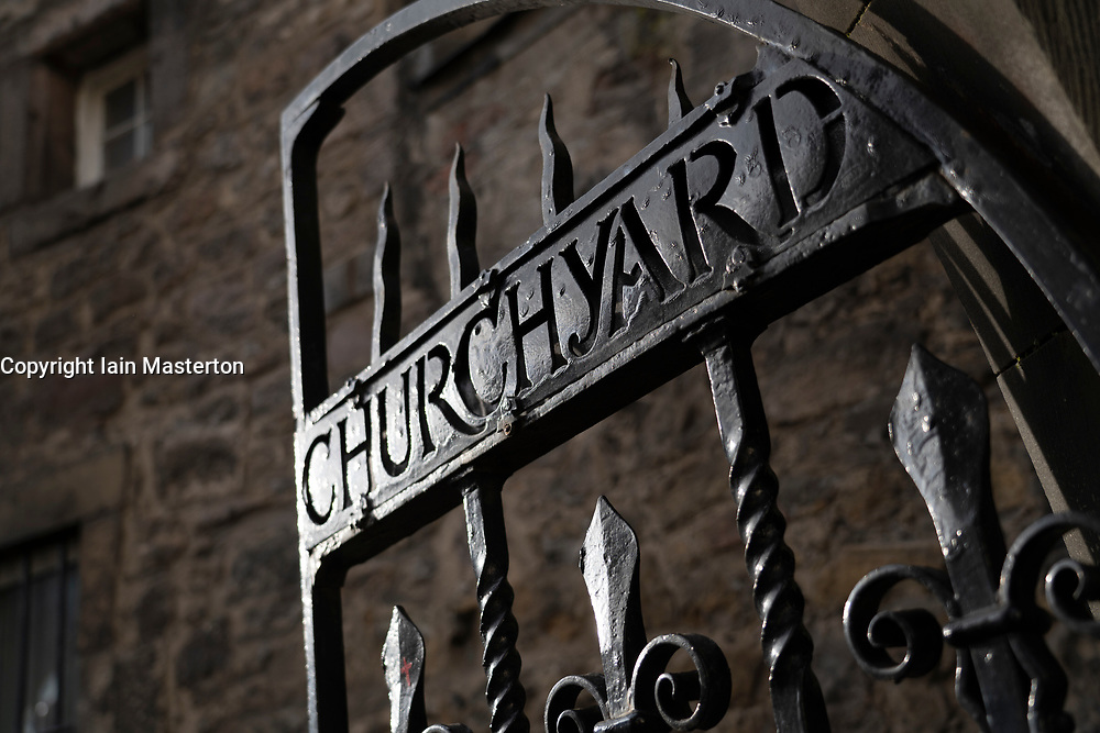 Iron gates at entrance to Greyfriars Churchyard on Candlemakers Row in Edinburgh Old Town, Scotland, UK