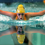 Edinburg North High School's Rachel Basaldua takes a breath while competing in the Girls 100 Yard Butterfly during the 2006 District 31-5A Swimming and Diving Championships at McAllen Rowe High School.<br /> Nathan Lambrecht/The Monitor