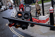 Traffic lights have been accidentally knocked over by the unsighted driver of a reversing articulated lorry on Leadenhall in the City of London, the capitals financial district, on 24th May 2021, in London, England.