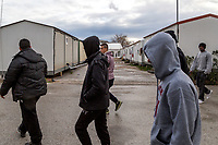 ATHENS, GREECE - FEBRUARY 05: Refugees walk inside the Eleonas refugee camp on February 05, 2015 in Athens, Greece. Hundreds of refugees are transferred every day to Eleonas refugee camp while waiting to travel to the Macedonian border. Photo: © Omar Havana. All Rights Are Reserved