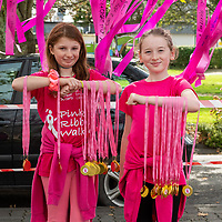 REPRO FREE<br /> Kate McCarthy and Holly O'Donovan from Kinsale handing out medals at the 2019 Kinsale Pink Ribbon Walk in aid of the Irish Cancer Society Action Breast Cancer.<br /> Picture. John Allen