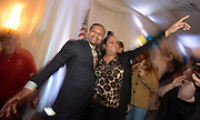 Aurora mayoral candidate Richard Irvin celebrates with supporter Kim Meeks of Aurora after his victory over Rick Guzman, during at his election night party at Gaslite Manor Banquets in Aurora.