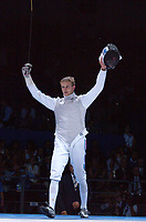 Brice Guyart (France) celebrates winning the Mens Foil Gold Medal. Fencing, Athens Olympics, 16/08/2004. Credit: Colorsport / Matthew Impey DIGITAL FILE ONLY