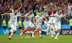 Russia's Vladimir Granat, Aleksandr Yerokhin, Aleksandr Golovin, Fyodor Kudryashov, Roman Zobnin, Ilya Kutepov, and Fyodor Smolov celebrate defeating Spain 4-3 on penalties