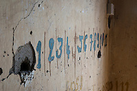 Painted numbers to keep cell keys in Building C at Tuol Sleng Genocide Museum, Phnom Penh, Cambodia