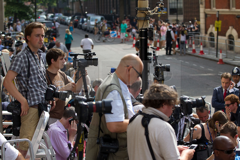 © Licensed to London News Pictures. 22/07/2013. London, UK. Media are seen gathered outside the Lindo Wing of St Mary's Hospital in Paddington, London, today (22/07/2013), after the Duchess of Cambridge was admitted with labour pains early this morning. Photo credit: Matt Cetti-Roberts/LNP