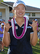 18 APR15  LPGA Rookie Sei Young Kim celebrates on the 18th green at the conclusion of Saturday's Final Round of The LOTTE Championship at The Ko Olina Golf Club in Kapolei, Hawaii. (photo credit : kenneth e. dennis/kendennisphoto.com)