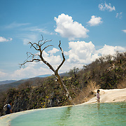 People swimming in a mineral spring pool at Hierve el Agua in Oaxaca, Mexico