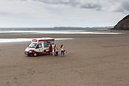 Ice cream van on empty beach on Pendine Sands, Carmarthenshire, Wales