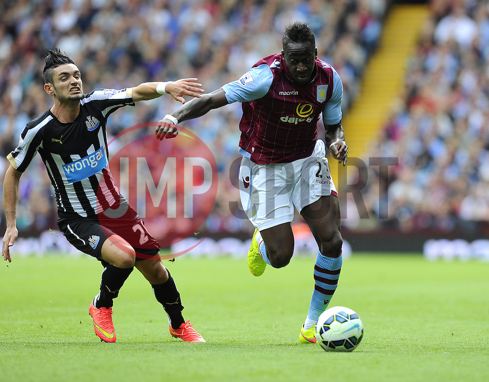 Aston Villa's Aly Cissokho battles for the ball with Newcastle United's Remy Cabella - Photo mandatory by-line: Joe Meredith/JMP - Mobile: 07966 386802 23/08/2014 - SPORT - FOOTBALL - Birmingham - Villa Park - Aston Villa v Newcastle United - Barclays Premier League