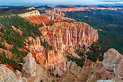 An approaching autumn storm is visible on the ampitheater cliffs in this view from Rainbow Point in Bryce Canyon National Park, Utah. Bryce Canyon is known for its ampitheater full of hoodoos, or spires, are remanants of large sandstone fins that have been subjected to centuries of erosion.
