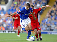 Photo: Ashley Pickering.<br /> Ipswich Town v Coventry City. Coca Cola Championship. 22/09/2007.<br /> Jonathan Walters (L) of Ipswich holds off Jay Tabb of Coventry