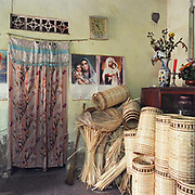 Interior of a home in Ninh So, bamboo basket weaving village, Ha Tay province, Vietnam. With Vietnam's growing population making less land available for farmers to work, families unable to sustain themselves are turning to the creation of various products in rural areas.  These 'craft' villages specialise in a single product or activity, anything from palm leaf hats to incense sticks, or from noodle making to snake-catching. Some of these 'craft' villages date back hundreds of years, whilst others are a more recent response to enable rural farmers to earn much needed extra income.