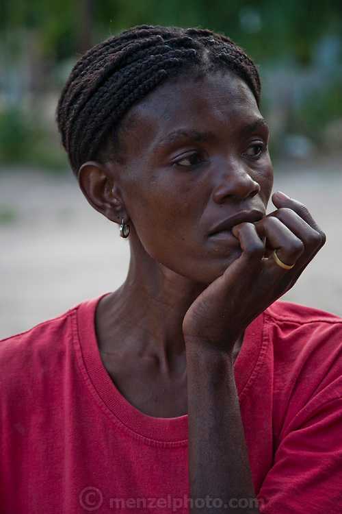 Marble Moahi, a 32 year-old mother living with HIV/AIDS, at her home in Kabakae Village, Ghanzi, Botswana. (Featured in the book What I Eat: Around the World in 80 Diets.) MODEL RELEASED.
